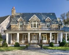 Now, that's a front porch!! stone front, metal roof, white columns, Front Door, Stacked Stone Exterior Design, Pictures, Remodel, Decor and Ideas