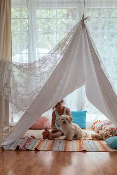 Child playing tent at home.  by Dejan Ristovski for Stocksy United