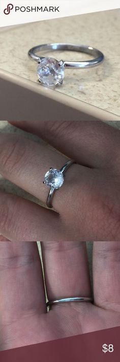 Cubic Zirconia Ring Simple ring with single cubic zirconia stone. No stamps for true silver. Shiny with minimal scratches (if any), great condition!! Ring Size: 8.5. Please feel free to make an offer!! 💍💍 Jewelry Rings