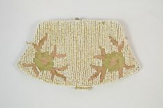 Vintage seed bead coin purse clutch.  The size of a coin purse with a glove holder strap on the back of the clutch. Beautiful embroidered