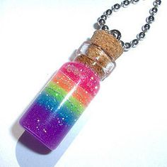 Pretty rainbow 🌈 glitter ✨ in a bottle necklace Bottle Jewelry, Bottle Charms, Bottle Necklace, Diy Necklace, Jar Crafts, Crafts For Kids, Resin Crafts, Glitter Wallpaper Iphone, Magical Jewelry