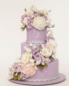 Pretty three tier lavender wedding cake with sparkly silver detail; Featured Cake: Ron Ben-Israel Cakes