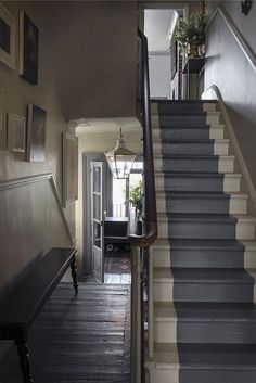 FOYER – great example of an impressive way to welcome guests. Stripe. Maybe for the hidden staircase.