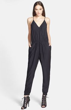 Free shipping and returns on Trouve Trouvé Surplice Jumpsuit at Nordstrom.com. A drawstring waistband cinches the retro-cool silhouette of this silky surplice jumpsuit while slick faux-leather spaghetti straps add a touch of edge.