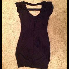 LBD!! Hot little black dress with cut out detail LBD!! Hot little black dress. Stretchy with deep V in the front and back. Back has a cut out design as seen in 2nd pic. NWOT. Perfect condition. Agaci Dresses