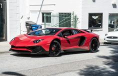 Lamborghini Aventador Super Veloce Coupe painted in Rosso Bia  Photo taken by: Chris Morrison on Flickr