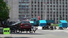 Ukraine: Seized APC on show outside Donetsk People's Republic HQ