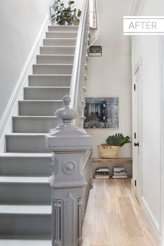 Light-wood floors give a gloomy stairwell a bright new look.