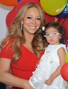 Mariah Carey posed with Monroe Cannon. Even celebrity children look great in glasses!