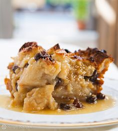 Authentic New Orleans bread pudding with French bread, milk, eggs, sugar, vanilla, spices, and served with a Bourbon sauce. ~ SimplyRecipes.com