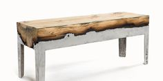 Hilla Shamia's wood casted side tables, benches, stools and coffee tables have been created by pouring molten aluminum onto the rounded, bark side of square sawn timber. Pinworthy Chairs We Love at Design Connection, Inc. | Kansas City Interior Design http://www.DesignConnectionInc.com/Blog #InteriorDesign