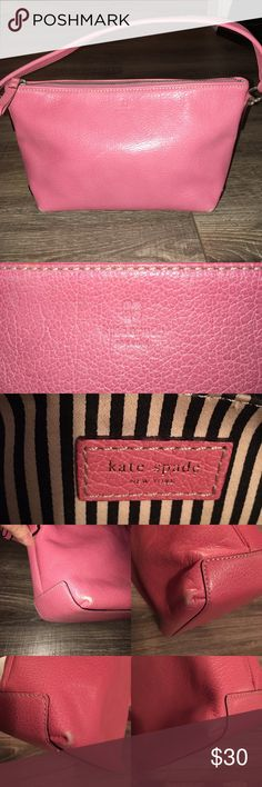 Authentic Kate Spade Pink Leather Purse Authentic Kate Spade Pink Leather Purse: Great condition! The pink leather is in great condition and the inside lining is super clean. There are a few scuffs on the bottom edges of the bag- please see pictures above. It comes from a smoke free home. kate spade Bags