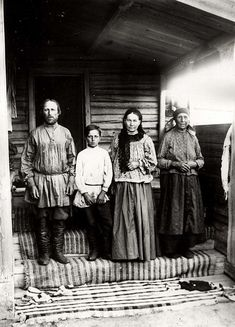 A peasant family, 1905. The stairs are covered with hand-made rugs.