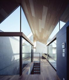 NEUT by Apollo Architects & Associates You don't go wrong with wood and glass and black colour. You can only make it better.