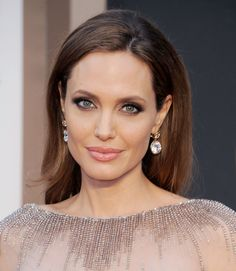 Angelina Jolie sported a set of megawatt earrings. #Oscars #Redcarpet