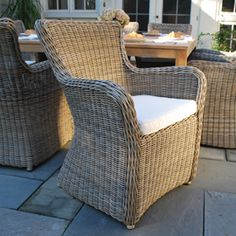 Love this! Especially in the Mocha color ratan! Garden Cottage - Sag Harbor 8-Seat Dining Set, (http://www.gardencottage.com/sag-harbor-8-seat-dining-set/)