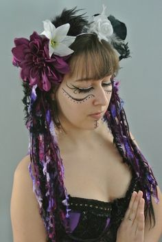 tribal belly dance purple headdress, ATS, flower, feather. $60.00, via Etsy. It's not the head dress I'm taken by but the make up!! I will be doing this :-D
