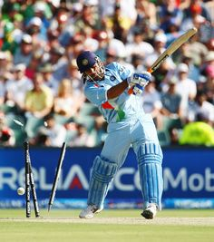 Mahendra Singh Dhoni is bowled by Umar Gul