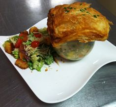 This isn't your mother's chicken pot pie! Peas, carrots, spinach and roasted tomatoes swimming with  tender chicken and topped with a crusty puff pastry lid! Served with our house  salad. $8.99. Try this and more delicious dishes at Leo Bistro at The Dayton Art Institute. Check out the menu at www.leobistro.com. House Salad, The Bistro, Chicken Tenders, Roasted Tomatoes, Delicious Dishes, Pot Pie, Spinach, Carrots, Leo