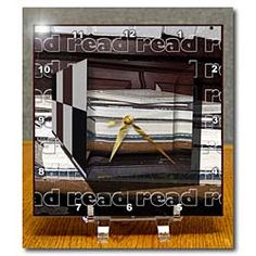 The word read written on background with a 3D Repousse in books Desk Clock