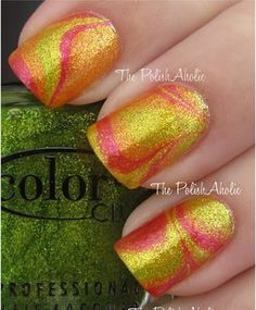 Swirly orange, yellow, and pink nail design I love it! Going to the nail salon right now going to ask for this!!