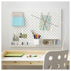 This Pegboard Combination—with its elastic cords, letter holder, clips, and various bins—feels right at home over a desk; $33.99.