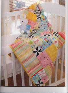 I never would have thought the black and white bits would perk a baby quilt up so!  [DUQ Girlie Pinwheels by lurline.geoghegan, via Flickr]