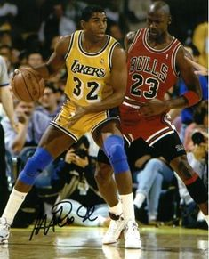 Magic Johnson signed Los Angeles Lakers 8x10 Photo (yellow jersey post up dribble vertical vs Michael Jordan- black sig)
