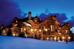 The Lure of the Rockies: A Rustic Colorado Log Home Glowing on a wintry night, this luxurious retreat home snuggles into a sloped lot overlooking the Gore Mountains in central Colorado. The varied roofline echoes the mountains' peaks. Log Homes Exterior, Mansion Homes, Log Cabin Homes, Log Cabins, Log Cabin Resort, Cabins In The Woods, House Goals, Rocky Mountains, Home In The Mountains