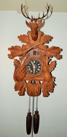 Antique German Black Forest Hunters Cuckoo Clock. This is a beautiful LARGE cuckoo clock. It is a 2 weight clock. It runs for 8 days on Etsy, $325.00