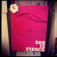 Wooden letters on spray painted canvas and and book page flower. This was super easy to do :)