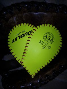 $18  Heart Made from a genuine Softball,can be used as a brooch, or attached to a head band or clipped on to a hat.  You can add your favorite players # to the ball, each one is individually created with its own personality.  Enjoy your one of a kind work of art.