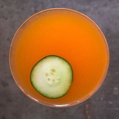 This bright orange cocktail pairs cucumber-and-rose-scented Hendricks gin with fresh carrot, lemon, and orange juices.