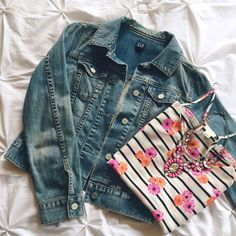 "GAP Jean Jacket A jean jacket is a must have for spring and this medium colored denim goes with everything! It's perfectly worn in and super soft but still in excellent shape, one minor wear hole is starting on the left elbow (see pic). 32"" across when buttoned and 19"" long. Fits more like an S than XS. GAP Jackets & Coats Jean Jackets"