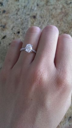 Oval engagement ring with pave band. Love the size of this not too flashy and will still be ok for teaching.
