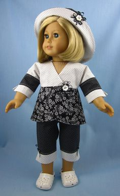 Sized to fit American Girl, and other 18-inch dolls, the set includes capri pants, wrap top and a jaunty hat.    The fully lined, wrap top has 3/4-length sleeves and is done in three coordinating cotton fabrics: a pretty, black and white floral print, black dots on a white background, and white dots on a black background. The top is embellished with a rosette of black and white dotted ribbon and a white, flower-shaped button. It closes with a single snap.    The white-on-black capris are...
