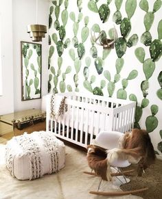 Fun wallpaper (don't love the cactus print for us, but like that it's a little playful). SCOTT: How many animals were sacrificed to appease this baby's decorating preferences?