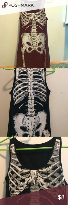 Skeleton tank top dress. Never worn, nwot. Size s Very cute tank dress from Spirit Halloween. Size small has skeleton design on front and back. Never worn, been sitting in my closet. Spirit Halloween Dresses