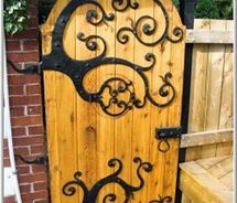 whimsical gate with hobbit peephole picture on VisualizeUs - would be a cute design for a fairy door as well