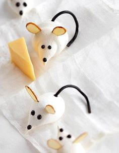 These easy Christmas cookies for kids are as simple to make as they are cute. Almond slivers make the ears, licorice forms the tail, and chocolate decorating gel is all you need to create the eyes and nose. #christmascookies #decoratedcookies #forkids #cuteholidaycookieideas #easy #bhg