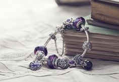 I LOVE the pandora collection. This one is so beautiful with all the purple...cant wait to start mine and add to my daughters :)