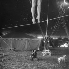 Two Small Children Watching Circus Performer Practicing on Tightrope, Her Legs Only Visible Photographic Print
