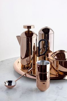 Tom Dixon's Brew set in precision-engineered from stainless steel, with a high-gloss copper finish.