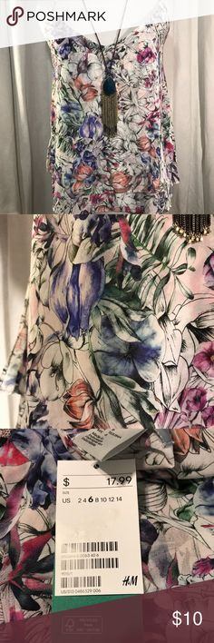 NWT H&M Boho Flower 🌸 Cami 🌺🌸🌼🌺🌸🌼 NWT Bohemian Flower Cami, with spaghetti straps. Front and Back is a V Neck. The measurement from top to bottom is 17' Long. There is two layers of material, not see-thru. The top is flowy, I have Sizes 4 & 6. H&M Tops Camisoles