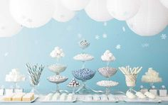 Create a DIY winter backdrop for your holiday party dessert table using paper lanterns, hanging snowflakes, and delicious candy. New Year's Desserts, Bar A Bonbon, Party Fiesta, Bleu Pastel, Winter Wonderland Party, Blue Party, Baby Shower, Frozen Party, Frozen Theme