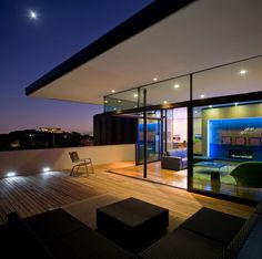 Love the cantalevered roof. slide away glass walls makes for ideal outdoor living, love the wood floors indoors and out