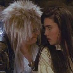 """This picture is a bit funny because of the way Sarah is looking at the Goblin king."""" and Jareth smirks at. David Bowie Labyrinth, Labyrinth 1986, Labyrinth Movie, Labyrinth Quotes, Sarah And Jareth, Jim Henson Labyrinth, Excellent Movies, Labrynth, Puffy Dresses"""