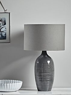 Crafted from ceramic with a deep grey glazed finish and subtle striated details, our slender, elegant table lamp will make a beautiful feature atop your hallway console or bedside table. Each lamp is finished with a stylish mid-grey linen shade. Shabby Chic Table Lamps, Cool Table Lamps, Farmhouse Table Lamps, Retro Table Lamps, Copper Table Lamp, Art Deco Table Lamps, Table Lamps For Bedroom, White Table Lamp, Bedside Table Lamps