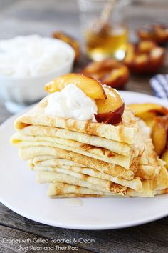 Crepes with Grilled Peaches & Cream Recipe on twopeasandtheirpod.com Great for dessert or breakfast!