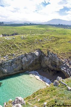 Mountains with snow surrounding the Puertu Cerrau beach in Llanes, Asturias. Yes, you read well, snow! In June!!!